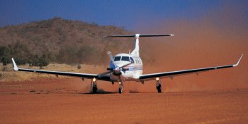 Pilatus PC12 on dirt runway